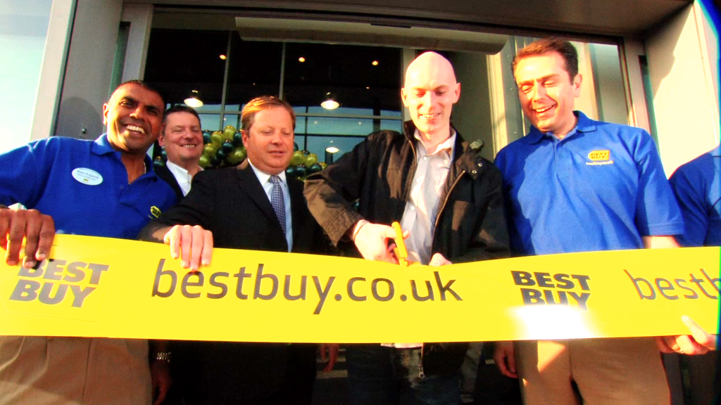 Best Buy men cutting ribbon